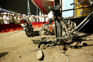 File picture of damaged vehicles at the blast site outside a mosque in Malegaon
