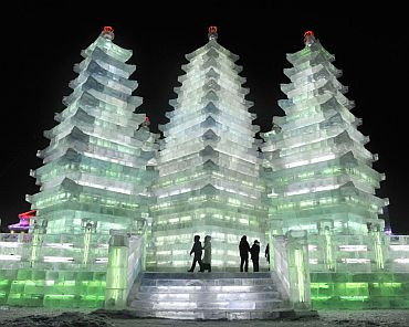 People visit tall ice pagodas