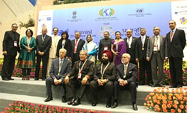 The winners of the Pravasi Bharatiya awards pose with President Pratibha Patil