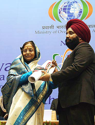 Upjit Singh Sachdev getting the award