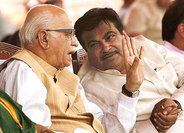 BJP president Nitin Gadkari with senior leader L K Advani
