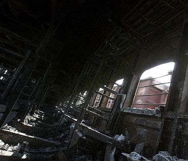 File photo of the charred Samjhauta Express compartment