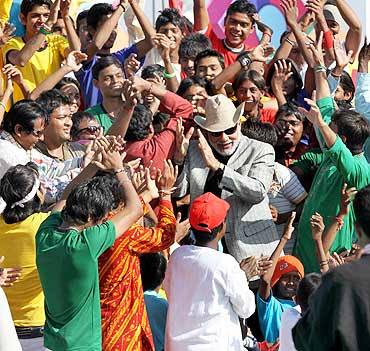 Gujarat CM Narendra Modi dances with participants at the International Kite Festival in Ahmedabad