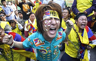 Tibetan exiles shout slogans during a protest outside the United Nations headquarters in New Delhi