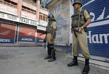 Paramilitary personnel during a curfew in Srinagar