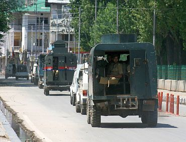 Military vehicles patrol the streets of Srinagar