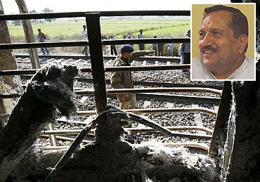 Inset: Indresh Kumar. Onlookers stand near a burnt carriage of Samjhauta Express train.