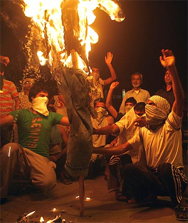 Protestors burn the effigy of Jammu and Kashmir Chief Minister Omar Abdullah