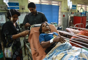 A devotee who was injured after the stampede rests inside a hospital at Kottayam in Kerala