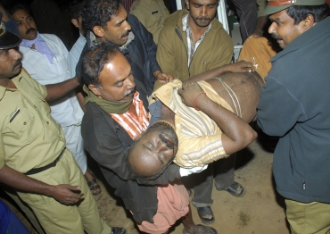 A devotee who was injured after the stampede is taken to a hospital at Kumily in Kerala