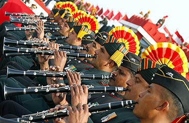 Soldiers play pipes during the Army Day parade in New Delhi