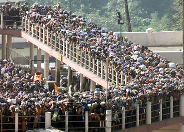 Pilgrims queue outside the Sabarimala Temple to offer prayers to Lord Ayappa