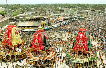 Devotees take part in the annual Jagannath Rath yatra in Puri