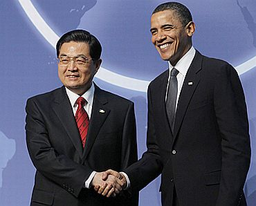 File photo shows Hu with US President Barack Obama