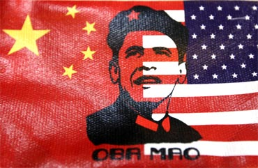 The cover of a wallet bearing an image of US President Barack Obama's face, in place of the usual image of China's late Chairman Mao Zedong, is pictured at a souvenir shop inBeijing on Tuesday
