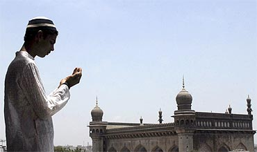 A man prays at the Mecca Masjid in Hyderabad