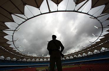 A soldier stands guard inside the Jawaharlal Nehru Stadium constructed for the 2010 Commonwealth Games during its inauguration ceremony in New Delhi