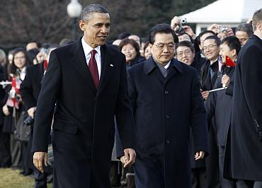 US President Barack Obama and Chinese President Hu Jintao walk past guests at the South Lawn