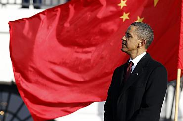 US President Barack Obama listens as Chinese President Hu Jintao speaks at the South Lawn