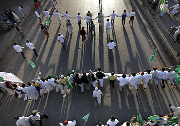 Supporters of various religious parties take part in a rally in support of the Pakistani blasphemy law in Karachi