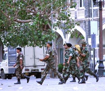 Paramilitary personnel surround Taj Mahal Hotel
