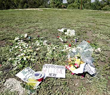 Flowers and candles from a vigil are seen at the park where Nitin Garg of India was stabbed in the western suburbs of Melbourne