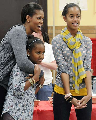 First lady Michelle Obama with daughters Sasha and Malia