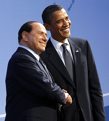 Obama greets Italian Prime Minister Silvio Berlusconi