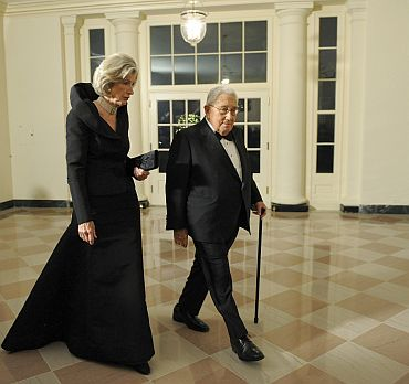 Former US Secretary of State Henry Kissinger arrives with his wife Nancy for the state dinner