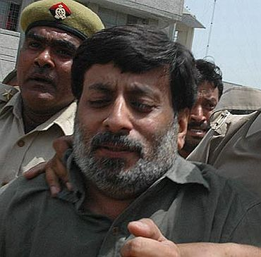 File photo of Rajesh Talwar being taken into custody
