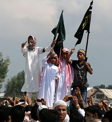 Children chant pro-freedom slogans during an anti-India procession in Srinagar