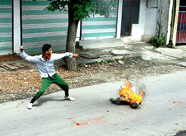 A protestor hurls stones at security forces in Srinagar