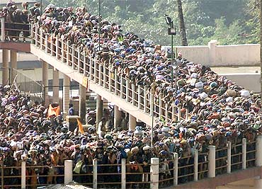 Pilgrims queue outside the Sabarimala Temple to offer prayers to Lord Ayyappa