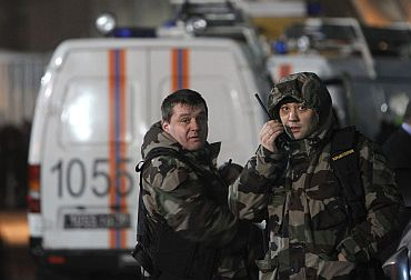 Members of the Federal Security Service work outside Moscow's Domodedovo airport following the blast