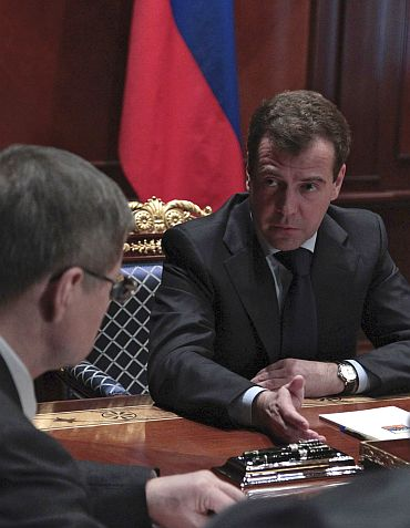 Russia's President Dmitry Medvedev talks to Prosecutor General Yury Chaika during a special meeting at the presidential residence outside Moscow following the blast on Monday