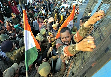A BJP supporter shouts slogans during a protest near the airport in Jammu