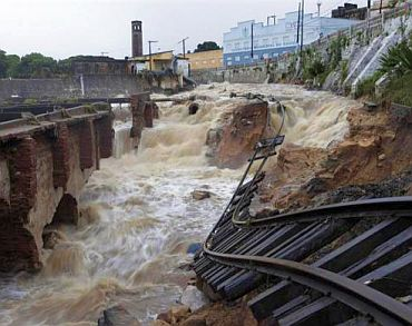 A destroyed railroad is seen after heavy rains in Rio Largo city, in the northeastern state of Alagoas, Brazil, June 23, 2010