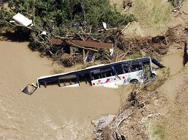 An aerial view shows a bus in the Nartuby river in Draguignan, southeastern France, June 18, 2010