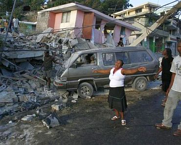 A woman reacts near destroyed buildings after an earthquake in Port-au-Prince, Haiti, January 13, 2010