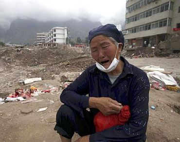 A 70-year-old woman cries for her relatives who died during a mudslide in Zhouqu of Gannan Tibetan Autonomous Prefecture, Gansu Province, China, August 17, 2010
