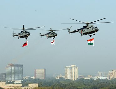 IAF Helicopters carrying the tricolour and services flag