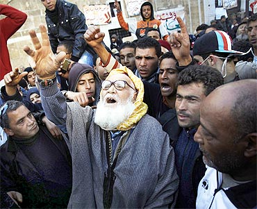 A man takes part in a demonstration in front of the prime minister's office in Tunis