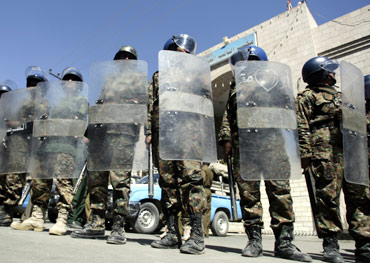 Anti-riot police stand guard outside the general attorney's office in Sanaa, Yemen