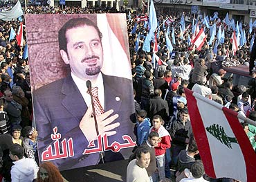 Supporters of Lebanon's caretaker Prime Minister Saad al-Hariri carry his picture during the Day of Anger in Tripoli