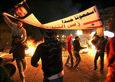 Supporters of Lebanon's caretaker Prime Minister Saad al-Hariri participate in a protest in Tripoli