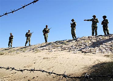 Border Security Force soldiers keep vigil at the India-Pakistan border