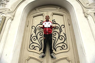 A boy holds on to the door as he shouts slogans during an anti-government demonstration in central Tunis