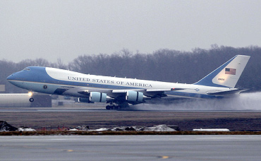 Air Force One kicks up snow and slush as it lands at Andrews Air Force Base with Obama aboard