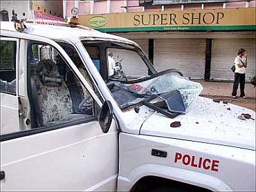 File Photo: A police vehicle that bore the brunt of protestors' ire