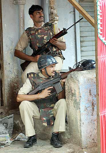 Policemen keep a watch near Nariman House in Mumbai during 26/11
